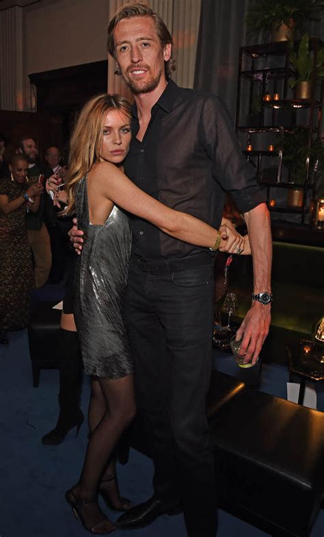 Abbey Clancy stuns in green dress at swanky Dubai party