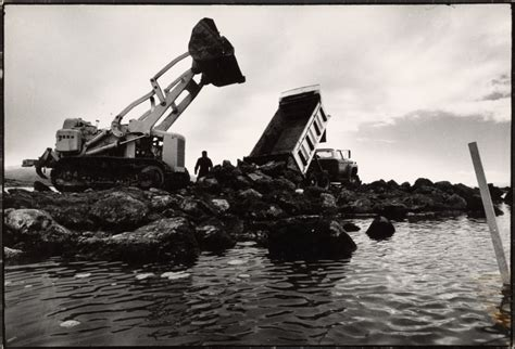 Building Spiral Jetty with truck and bulldozer, Great Salt