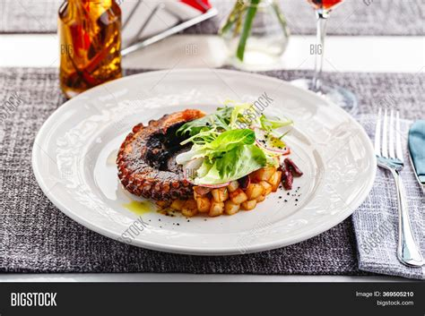 Octopus Tentacle Fried Image & Photo (Free Trial) | Bigstock